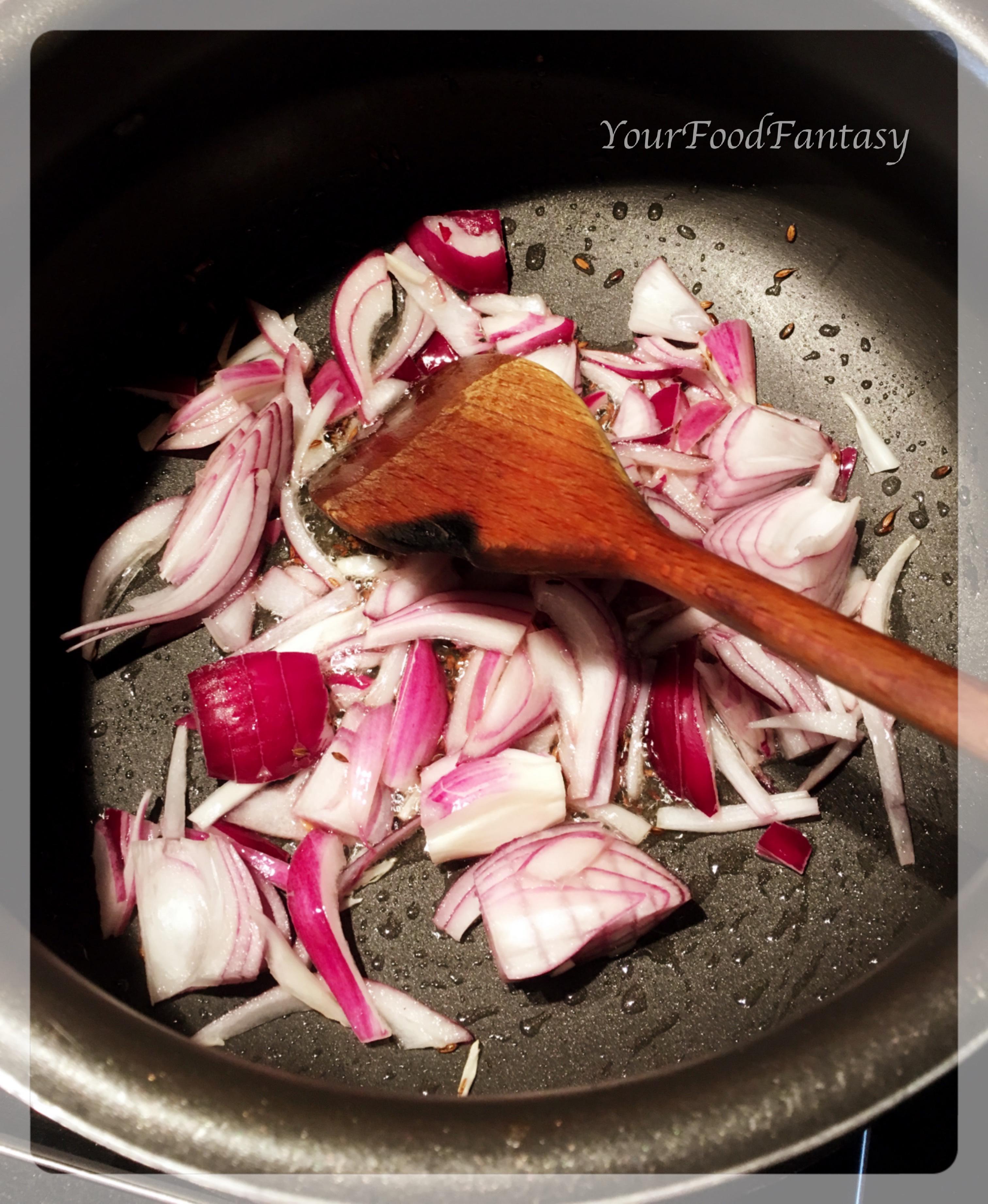 frying onion for masala paneer   yourfoodfantasy by meenu gupta