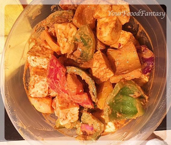 Mixing Paneer and Vegetables in marinade for paneer tikka