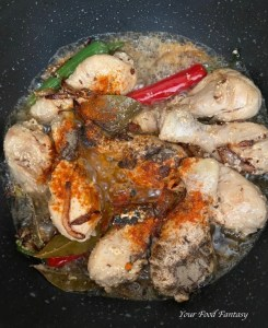 Adding spices for yakhni pulao