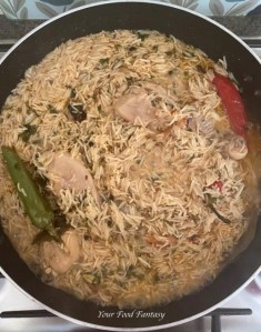 Cooking rice and chicken to make Yakhni Pulao
