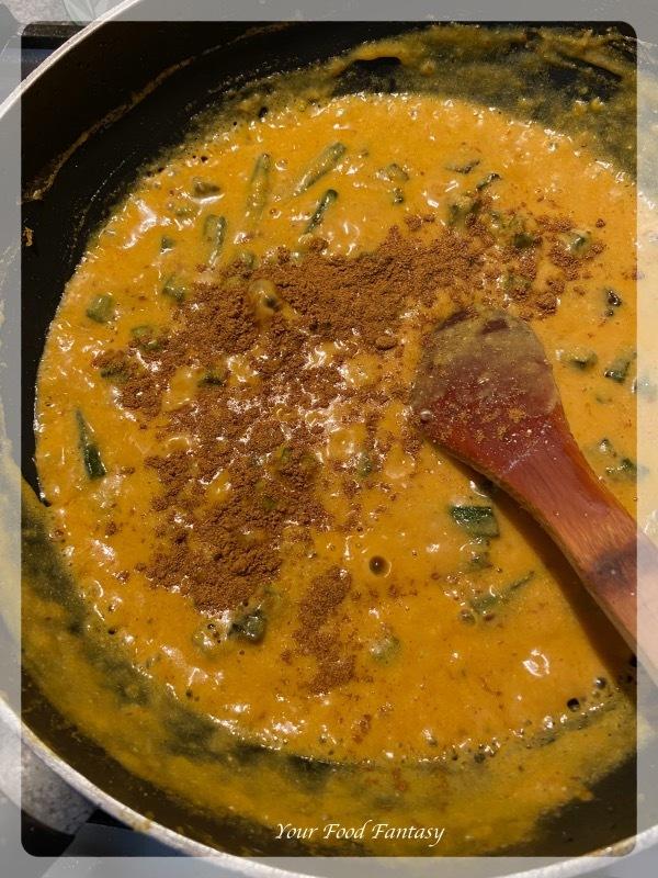 Adding Garam Masala to dahi bhindi