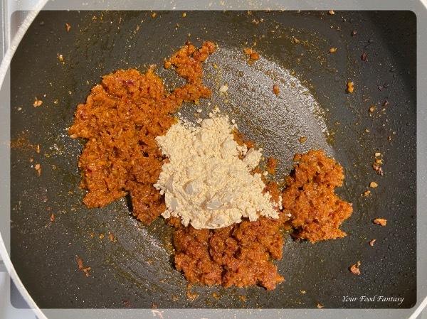 Adding gram flour - Dahi wali bhindi recipe