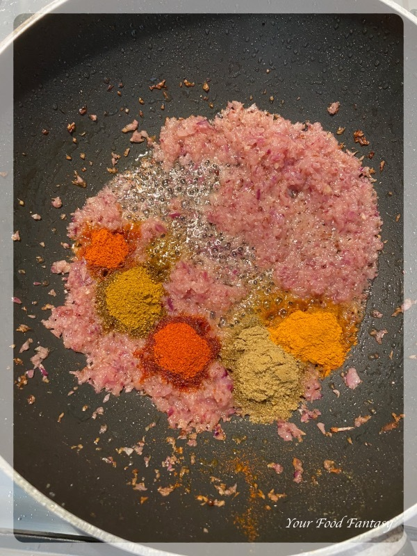 Adding spices for okra yogurt curry - dahi bhindi recipe